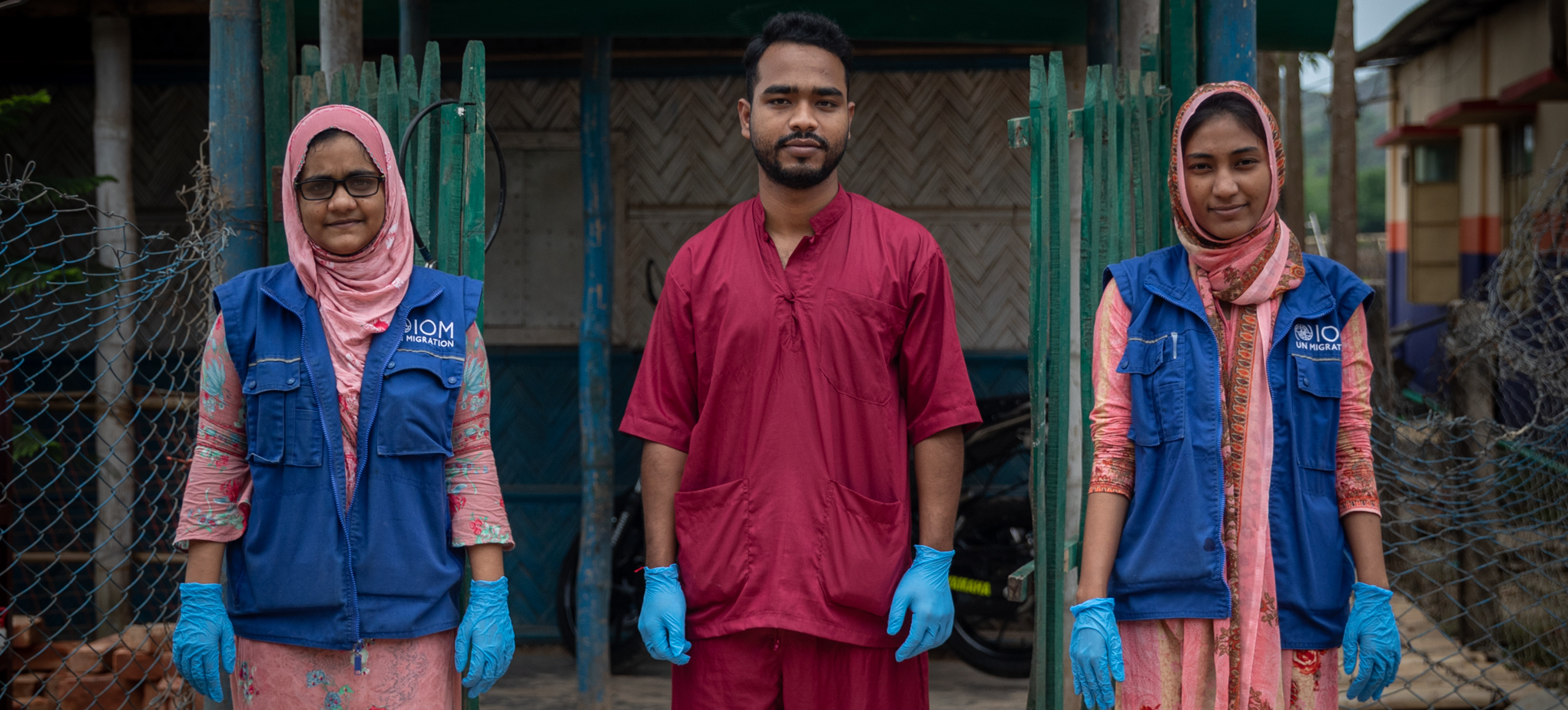 IOM Health staff pictured outside of a repurposed health facility in Cox's Bazar, that will serve as an Isolation and Treatment Center during the COVID-19 pandemic.